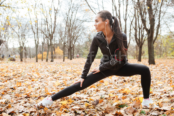Attractive woman runner make sport exercise Stock photo © deandrobot