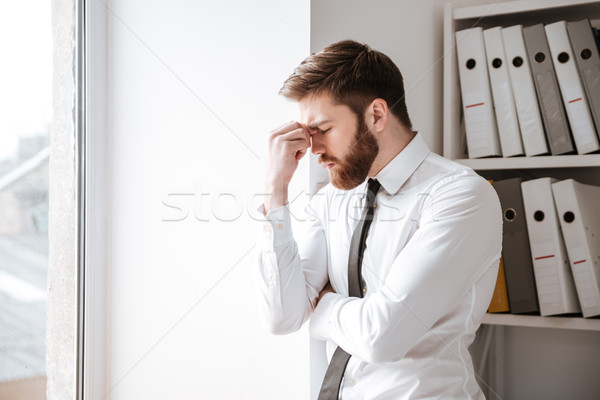 Fáradt fiatal üzletember megérint szemek kép Stock fotó © deandrobot