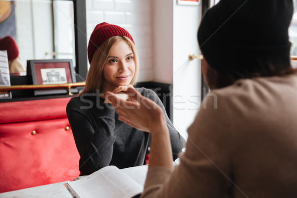 Dialogue of young couple in cafe Stock photo © deandrobot