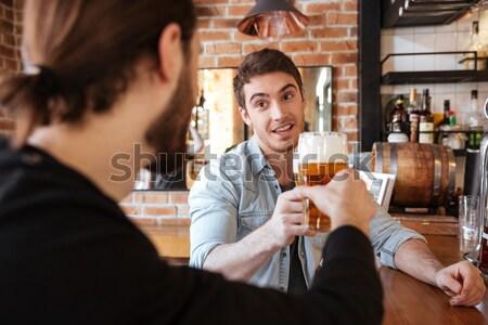 Atractivo joven camarero pie Servicio café Foto stock © deandrobot