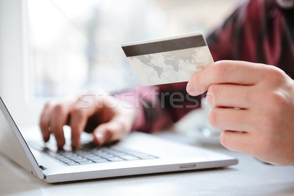 изображение удивительный молодым человеком дебетовая карточка сидят Сток-фото © deandrobot