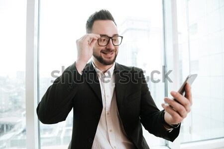 Smiling Bearded business man talking on phone Stock photo © deandrobot