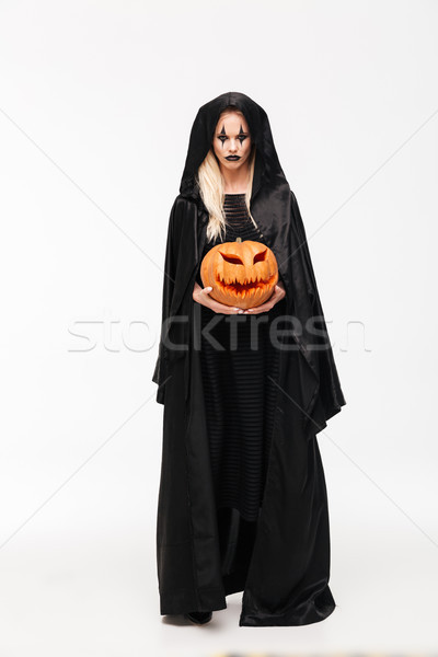 Full length portrait of a dreadful woman in halloween make-up Stock photo © deandrobot