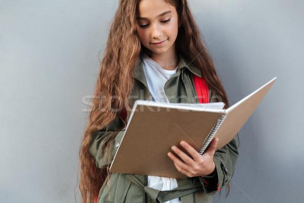 Souriant brunette écolière cheveux longs chaud vêtements Photo stock © deandrobot