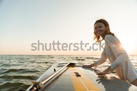 Stock photo: Close-up portrait of pretty smiling sport woman, holding bottle