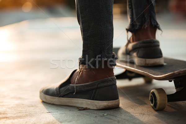 Close up of skateboarders feet skating Stock photo © deandrobot