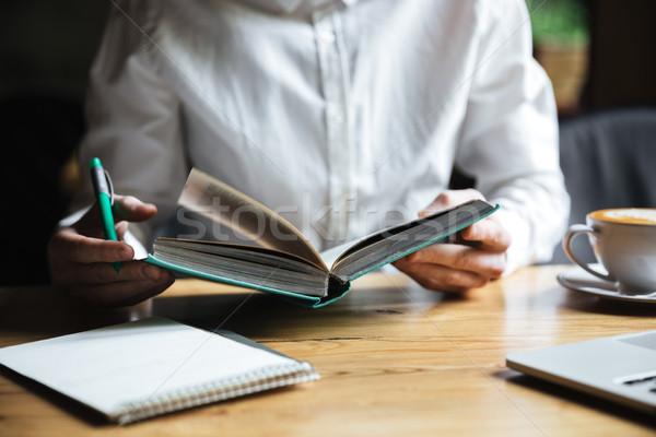 фото человека белый рубашку открытой книгой Сток-фото © deandrobot