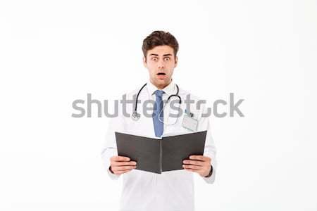 Portré ijedt fiatal férfi orvos sztetoszkóp egyenruha Stock fotó © deandrobot