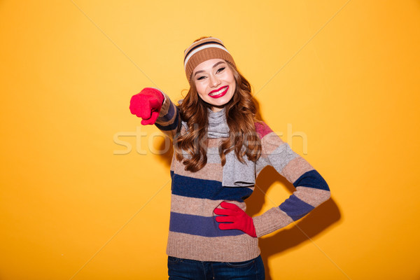 Portrait of a smiling girl dressed in winter clothes Stock photo © deandrobot