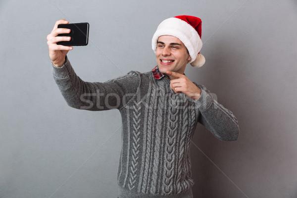 Boldog érzelmes férfi visel karácsony kalap Stock fotó © deandrobot