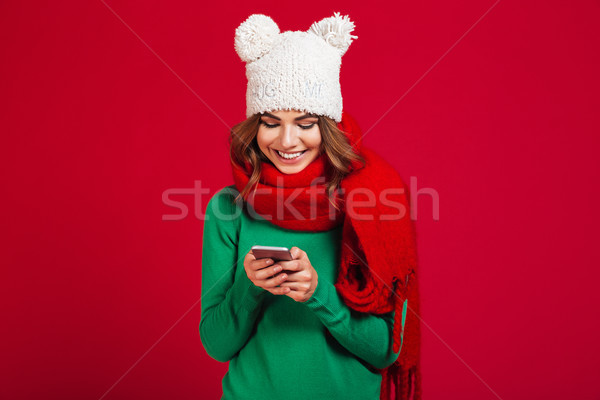 Cute pretty young woman wearing hat and scarf. Stock photo © deandrobot