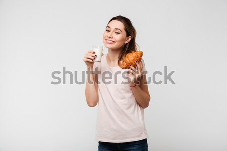 портрет улыбаясь Cute девушки еды круассан Сток-фото © deandrobot