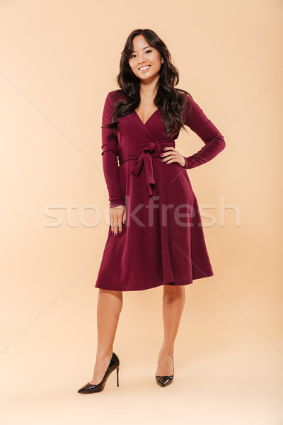 Full size portrait of charming asian female in pretty maroon dre Stock photo © deandrobot