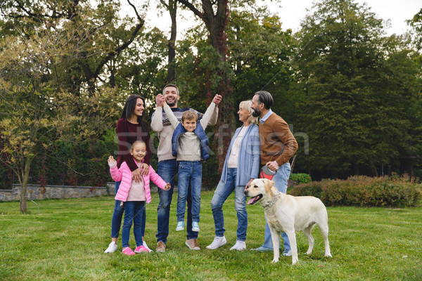 Stock photo: Happy big family with labrador retriever dog playing