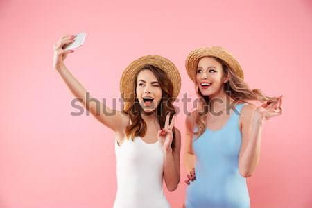 Сток-фото: молодые · смешные · дамы · улыбаясь · изолированный