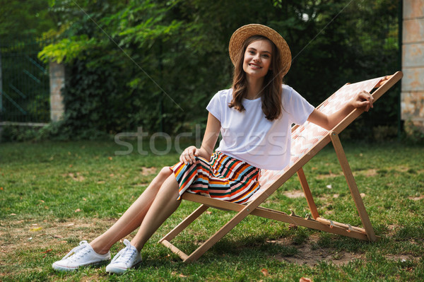 Cheerful young girl resting on a hammock Stock photo © deandrobot