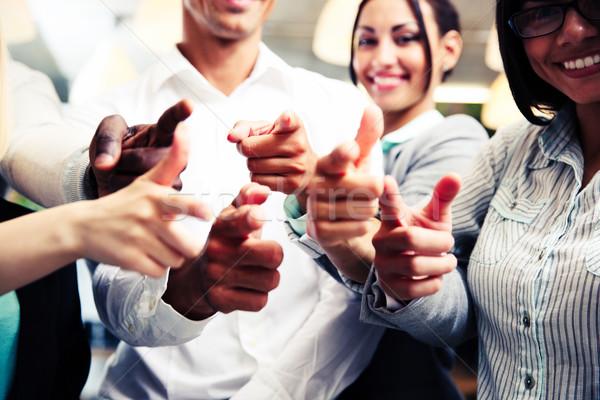 Mosolyog üzleti csoport kamera üzlet kéz mosoly Stock fotó © deandrobot