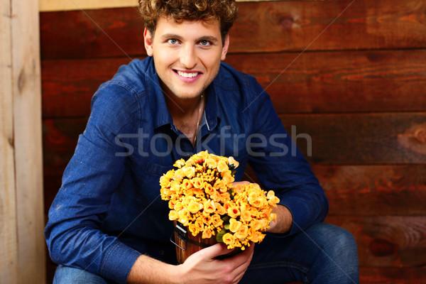 Mutlu adam kıvırcık saçlı oturma kova Stok fotoğraf © deandrobot