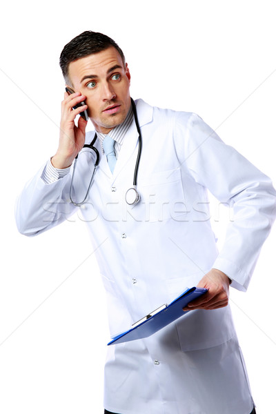 Scared male doctor talking on the phone over white background Stock photo © deandrobot