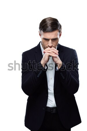Portrait of a pensive businessman isolated on a white background Stock photo © deandrobot