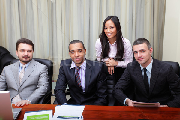 Multi ethnic business team at a meeting. Interacting. Focus on african-american man Stock photo © deandrobot