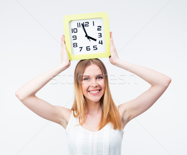 Happy woman holding big clock on head Stock photo © deandrobot