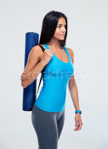 Fitness woman yoga mat gri uygunluk Stok fotoğraf © deandrobot