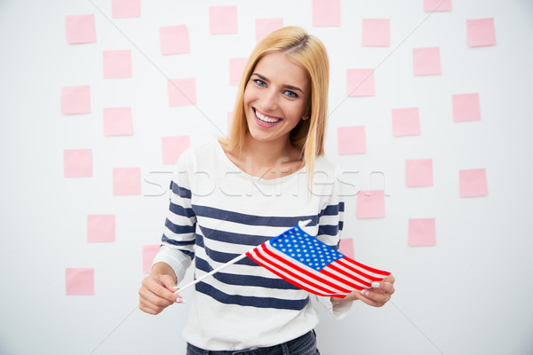 Happy patriotic woman holding US flag  Stock photo © deandrobot