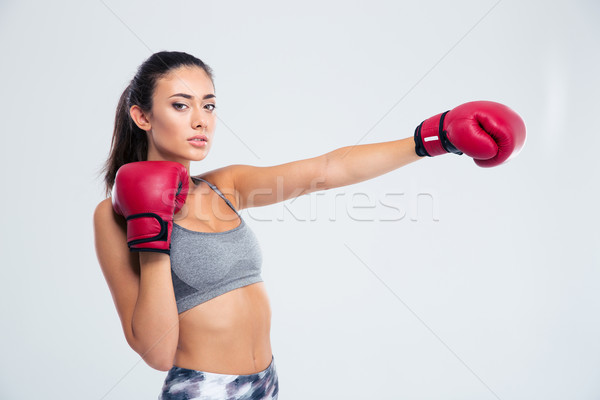 Portrait of a beautiful fitness woman in boxing glove Stock photo © deandrobot