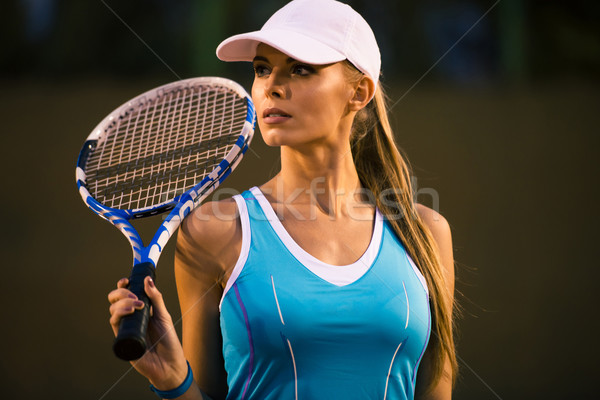 Woman playing in tennis  Stock photo © deandrobot