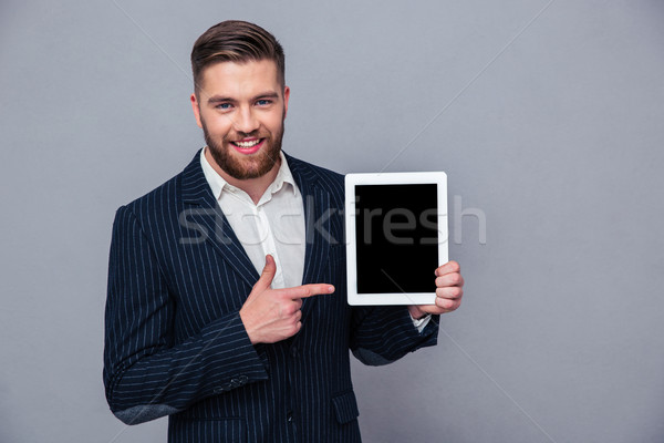 бизнесмен указывая пальца экране портрет Сток-фото © deandrobot