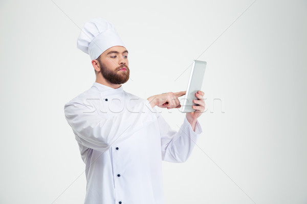 Male chef cook using tablet computer  Stock photo © deandrobot