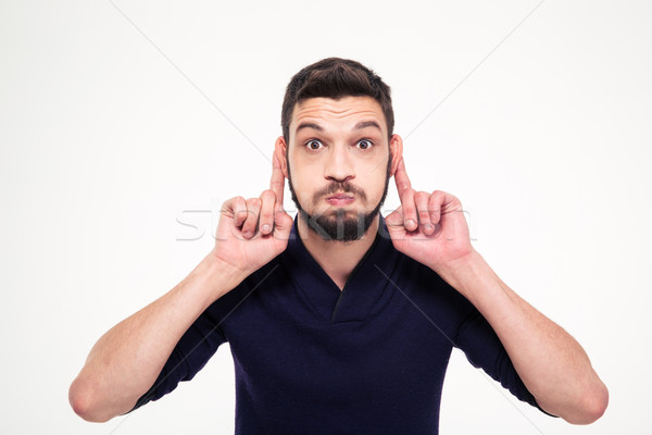 Amusing comic young bearded man making funny face  Stock photo © deandrobot