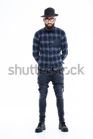 Attractive serious african american man standing with hands behind back  Stock photo © deandrobot