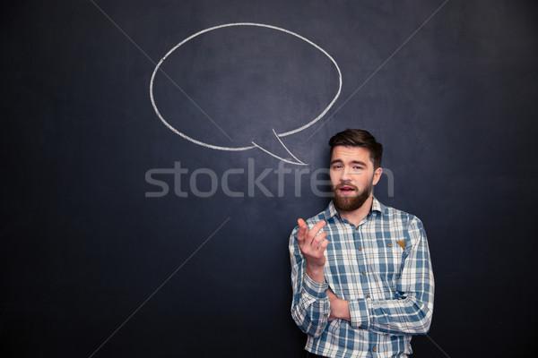 Szakállas férfi beszél iskolatábla rajzolt szövegbuborék Stock fotó © deandrobot