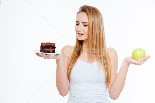 Confused woman choosing between healthy and unhealthy food Stock photo © deandrobot