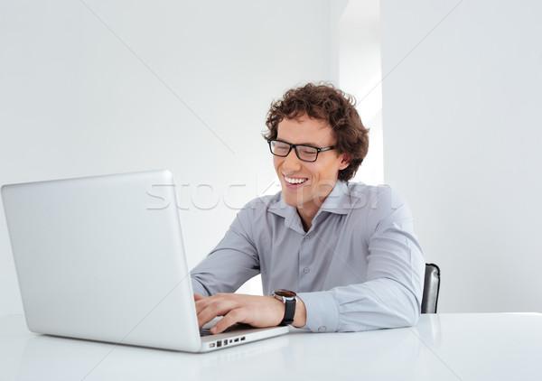Businessman working on laptop computer Stock photo © deandrobot