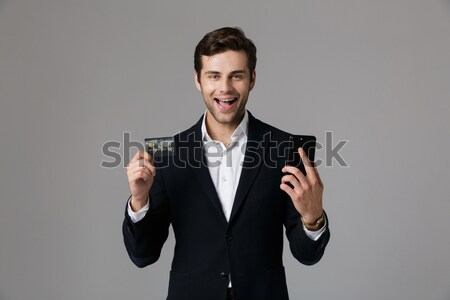 Happy confident man in tuxedo with bowtie pointing on you Stock photo © deandrobot