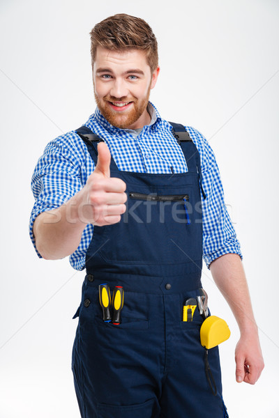 Happy male builder showing thumb up Stock photo © deandrobot