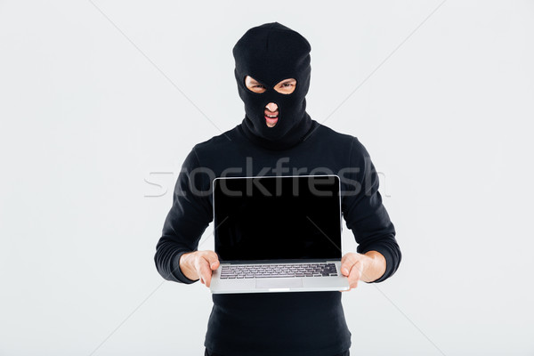 Crimineel man scherm laptop computer Stockfoto © deandrobot