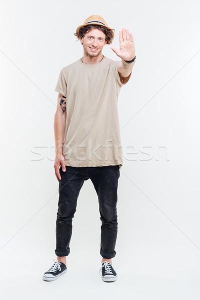 Stok fotoğraf: Tam · uzunlukta · portre · adam · dur · işareti · palmiye