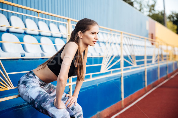 Young beautiful sportswoman leaning on the railing Stock photo © deandrobot