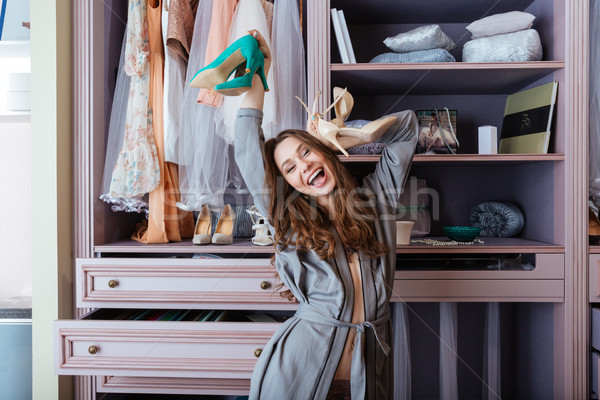 Young beautiful woman dancing in her wardrobe Stock photo © deandrobot