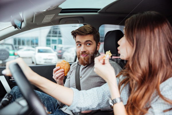 Couple eating in car Stock photo © deandrobot