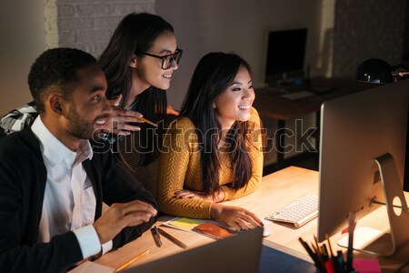 Business people working late at night in office Stock photo © deandrobot