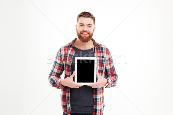Stock photo: Portrait of a smiling man showing blank tablet computer screen