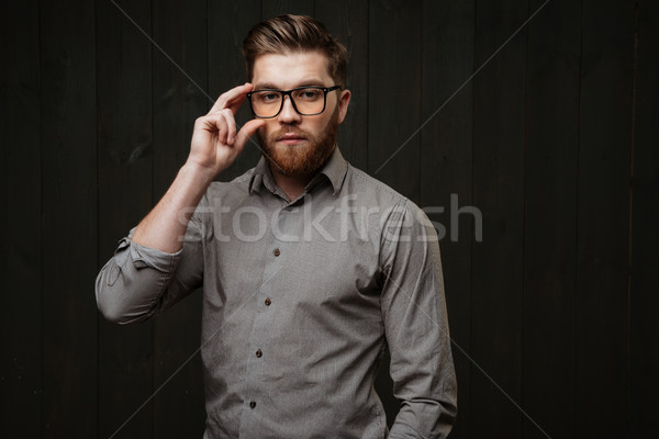Stylish bearded man in eyeglasses and shirt looking at camera Stock photo © deandrobot