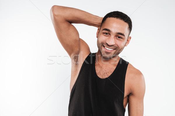 Dark skinned man wearing black clothes Stock photo © deandrobot