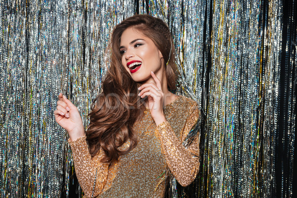 Alegre mulher jovem vestido de noite risonho bonitinho Foto stock © deandrobot