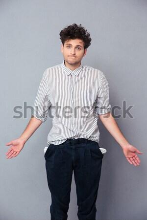 Stock photo: Full length portrait of Bearded man in shirt pointing away